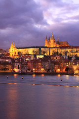 Colorful Prague gothic Castle above the River Vltava with Charles Bridge in the Evening, Czech Republic