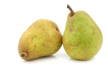"two fresh ""doyenne de comice"" pears on a white background"