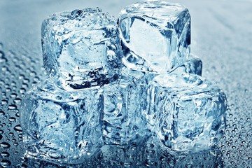 Close up view of some ice pieces in water