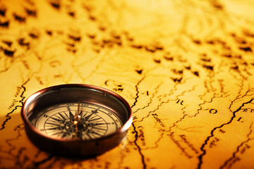 Close up compass on the old map