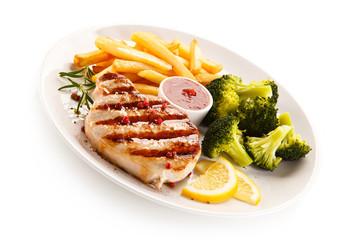 Grilled steak, chips and vegetable salad