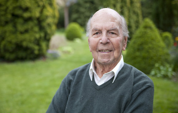 Portrait of 95 years old english man in his garden