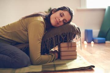 Attractive mixed race woman doing restorative yoga