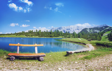 wooden bench beside a wonderful mountain lake