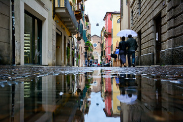 Verona street view with the puddle