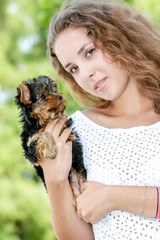 woman beautiful young happy with long hair holding small dog on