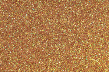 Golden glitter texture. Low contrast photo.