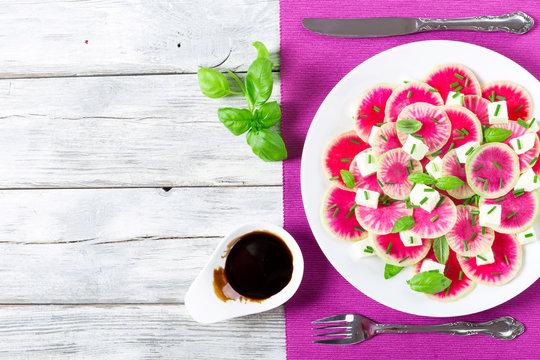 delicious watermelon radish salad with mozzarella, onion chives
