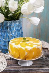 Party table with peach cheese cake