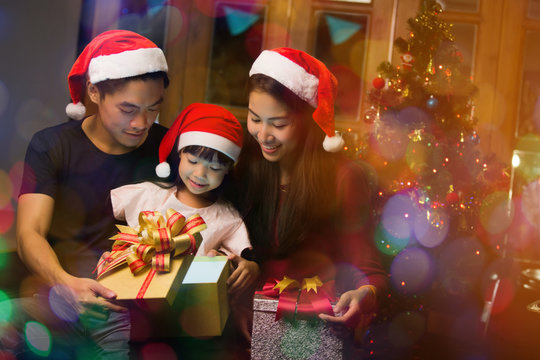 Asian family opening a gift box on christmas day happy
