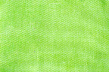 Blur abstract background. Green cotton fabric pattern