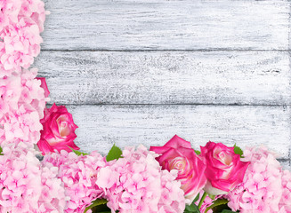 Roses and hydrangeas on shabby wooden planks