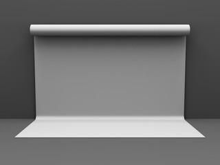 White backdrop on dark grey wall. Studio Background