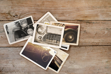 Classic car photo album on wood table. instant photo of polaroid camera - vintage and retro style
