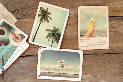 summer photo album on wood table instant photo of polaroid camera vintage and retro style. Black Bedroom Furniture Sets. Home Design Ideas