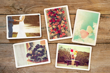 Wedding and honeymoon instans photo album on wood table. paper photo of polaroid camera - vintage and retro style