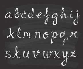 Set of script alphabet on chalkboard background