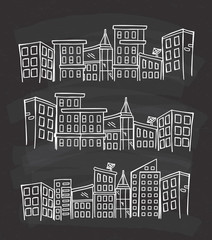 City skylines in cartoon doodle style on chalkboard background