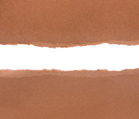 Brown package paper torn to reveal white panel ideal for copy sp