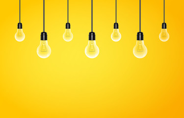 Hanging light bulbs on a yellow background with copy space. Vector illustration for your design.