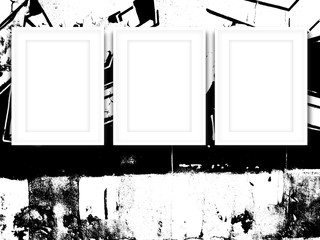 Close-up of three white picture frames on black and white ink splotchy background