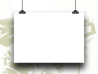 Close-up of one hanged horizontal poster with clips on light cream-colour ink splotchy background