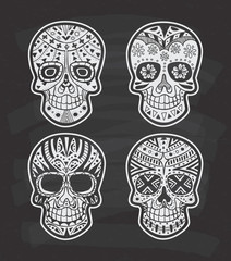 Set of sugar skull on chalkboard background