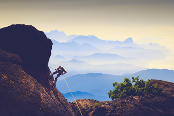 Climber against mountain valley