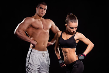 Young bodybuilder couple.