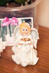angel holding wedding rings