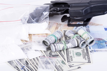 drugs,money,cocaine and gun