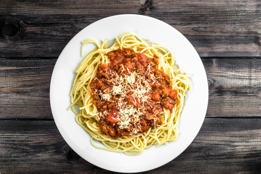 Cooked spaghetti bolognese on white plate..