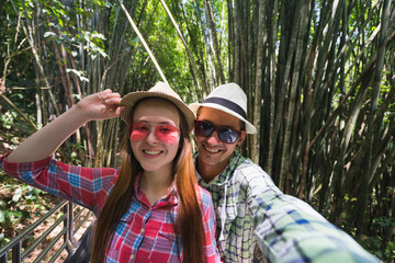 Couple make selfie in jungle. Travel concept.
