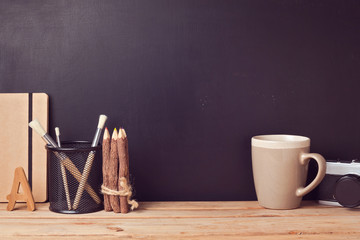 Website header design with designer vintage desk over chalkboard background