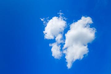 Clouds like broken heart on blue-sky