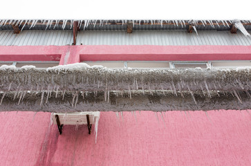 Large icicles hanging from a pipe on the nature
