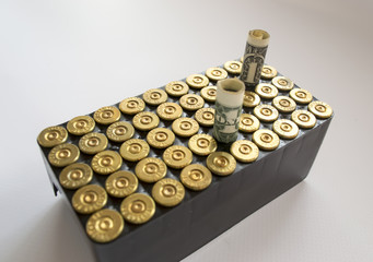 cassette with 38 caliber ammunition, and money , on a white back