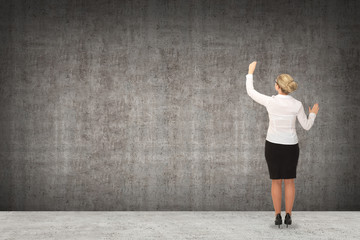Business woman drawing on the wall. business concept
