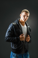 Strong Image of a very Tough Man in leather shirt on Black