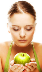 Young happy blond woman with apple