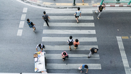 People across the crosswalk on top