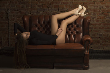 Attractive woman lying on the sofa