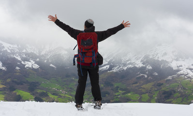 man looking a mountain covered of white snow