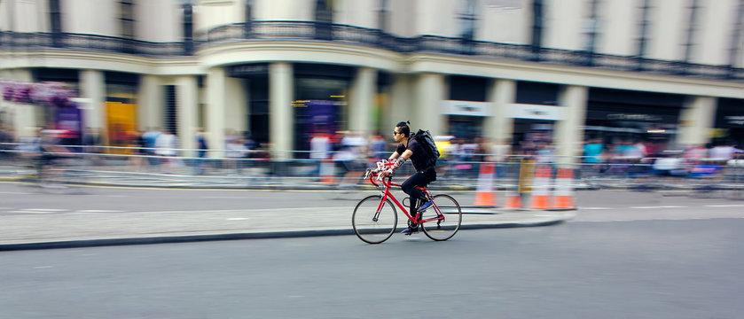 Cyclist Riding Bike Fast Through City. Speed Blur