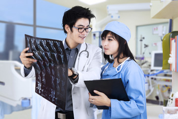 Doctors checking the patient xray film