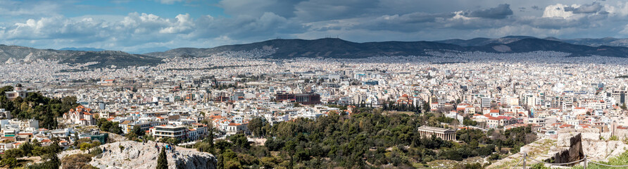 Panoramic Landscape of the ancient city of Athens with blue sky and clouds