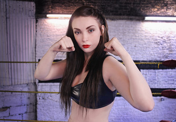 Strong Female Fighter. Raised Fists