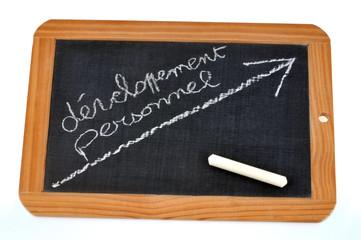 Ardoise avec développement personnel écrit dessus