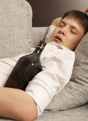 Drunkard. A young man with a drinking problem is relaxing