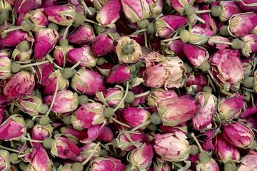 Dried rosebuds background texture closeup.